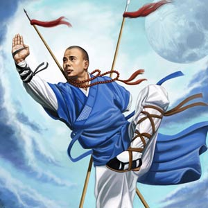 Shifu Xing-Wei, 32nd generation monk is on a mountain top, posing with two spears